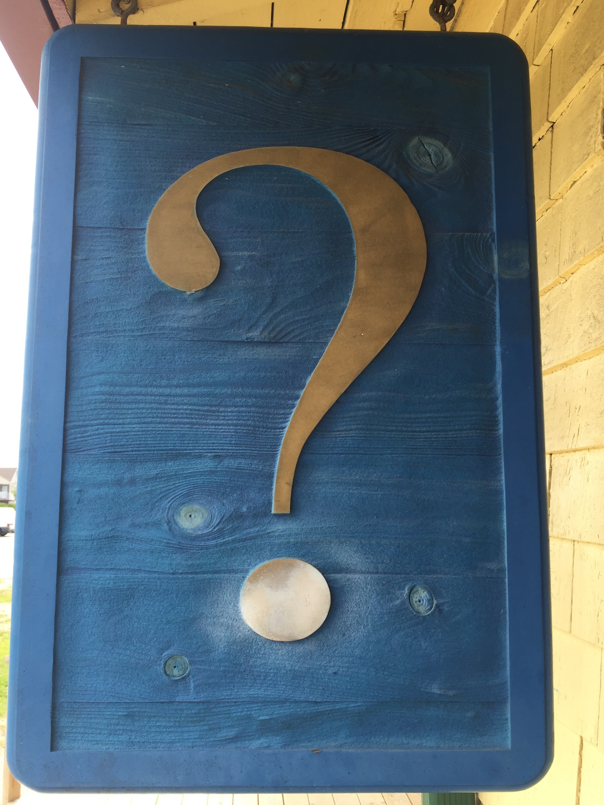 silver question mark with blue background