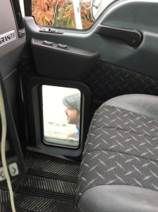 Image of the small window at the right side of a large truck