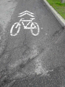 Sharrow painted bike sign